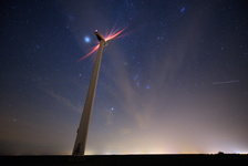 Wind turbine under the stars next to Falaise